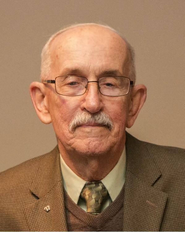 Dr. Raymond Adamek